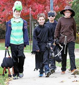 Candace H. Johnson-For Shaw Media Jimmy Pecora, 10, of Round Lake, Cole Pemberton, 8, of Fox Lake, his brother, Bryce, 10, and Frank Niecikowski, 10, of Round Lake go trick-or-treating in the Valley Lakes subdivision in Round Lake.