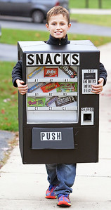 Candace H. Johnson-For Shaw Media Evan Marunde, 11, of Volo walks down the street in his vending machine costume while trick-or-treating in the Valley Lakes subdivision in Round Lake.