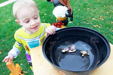 Candace H. Johnson-For Shaw Media Kory Daley, 3, of Lindenhurst gets a piece of candy during trick-or-treating in the Valley Lakes subdivision in Round Lake. Kory was trick-or-treating with his friend, Olivia Tuazon, 3, of Beach Park.