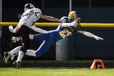 Johnsburg's Brody Frazier (23) comes up just short on the dive for the end zone Saturday, Oct. 29th, 2016 at Johnsburg High School in Johnsburg. Johnsburg went on to win the first round playoff game 56-14. KKoontz- for Shaw Media