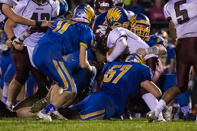 Johnsburg's defense led by Jarrid Wagner (57) sack quarterback Marengo quarterback Eric MacKay (15) Saturday, Oct. 29th, 2016 at Johnsburg High School in Johnsburg. Johnsburg went on to win the first round playoff game 56-14.  KKoontz- for Shaw Media
