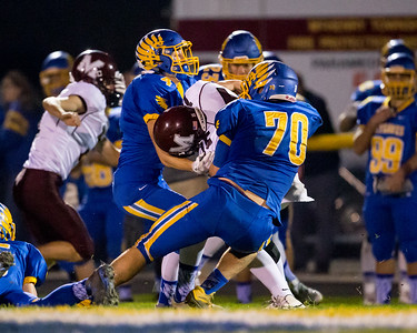 Johnsburg defenders Joe Moore (70) and Jarred Bergren (4) sack Marengo quarterback Eric MacKay (15) Saturday, Oct. 29th, 2016 at Johnsburg High School in Johnsburg. Johnsburg went on to win the first round playoff game 56-14.  KKoontz- for Shaw Media