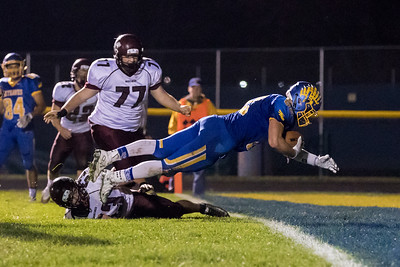 Johnsburg receiver Bryce Jordan makes the catch and dives into the end zone for the touchdown Saturday, Oct. 29th, 2016 at Johnsburg High School in Johnsburg. Johnsburg went on to win the first round playoff game 56-14.  KKoontz- for Shaw Media