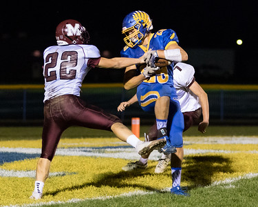 Johnsburg receiver Chuck Curry (29) makes the catch for the touchdown between Marengo defenders Joseph Miller (22) and Aaron Shepard (7) Saturday, Oct. 29th, 2016 at Johnsburg High School in Johnsburg. Johnsburg went on to win the first round playoff game 56-14.  KKoontz- for Shaw Media