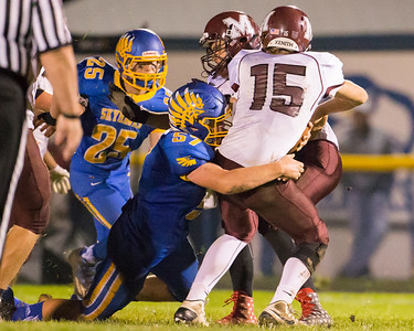 Johnsburg's Jarrid Wagner sacks Marengo quarterback Eric MacKay (15) Saturday, Oct. 29th, 2016 at Johnsburg High School in Johnsburg. Johnsburg went on to win the first round playoff game 56-14.  KKoontz- for Shaw Media