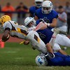 St. Charles North's Eric Lins tackles Carmel's Zaire Barnes  on Oct. 29 at the Class7A playoff game in St. Charles.