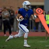 St. Charles North's Jason Shanner carries the ball against Carmel on Oct. 29 at the Class7A playoff game in St. Charles.