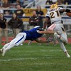 St. Charles North's Ryan Specht tackles Carmel's Zaire Barnes on Oct. 29 at the Class7A playoff game in St. Charles.