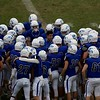 St. Charles North talks strategy against Carmel on Oct. 29 at the Class7A playoff game in St. Charles.