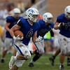 St. Charles North's Eric Lins recovers the ball against Carmel on Oct. 29 at the Class7A playoff game in St. Charles.