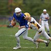 St. Charles North's Griffin Hammer carries the  ball as Carmel's George Curran goes for the tackle on Oct. 29 at the Class7A playoff game in St. Charles.