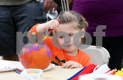 Avery Graham, 3, of Downers Grove paints a pumpkin Saturday, Oct. 1, 2016 at Fishel Park during Downers Grove Park District's Harvest Fest. Sarah Minor for Shaw Media