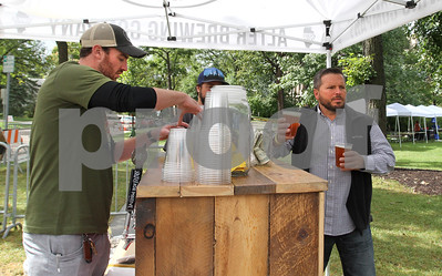 Steve Stracevich gets beer from the Alter Brewing Company Saturday, Oct. 1, 2016 during Harvest Fest at Fishel Park. Sarah Minor for Shaw Media