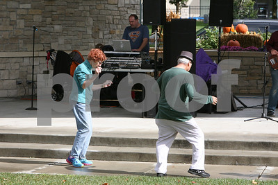 Donna and David Zellner of Downers Grove dance to live music Saturday, Oct. 1, 2016 during Harvest Fest at Fishel Park. Sarah Minor for Shaw Media