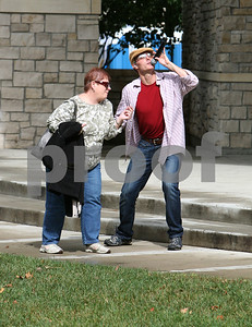 Teresa Dunne of Downers Grove sings and dances with the lead singer of The Hat Guys who performed Saturday, October 1, 2016 at Harvest Fest hosted by Downers Grove Park District at Fishel Park. Sarah Minor for Shaw Media