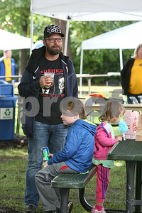 Allen Dougherty of Downers Grove watches live music Saturday, Oct. 1, 2016 at Fishel Park as his kids Aiden, 9, and Amelia, 3, enjoy a snack during Harvest Fest. Sarah Minor for Shaw Media