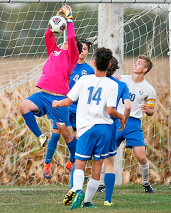 Stephan Turskey (30) from Woodstock makes a save in goal during overtime of their game against Johnsburg on Monday, October 2, 2017 in Johnsburg, Illinois. The Blue Streaks won the game 5-4 in a shoot out. John Konstantaras photo for Shaw Media