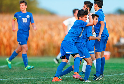 Angel Arias (13, right) from Woodstock celebrates his goal on a penalty kick during the second half of their game against Johnsburg on Monday, October 2, 2017 in Johnsburg, Illinois. The Blue Streaks won the game 5-4 in a shoot out. John Konstantaras photo for Shaw Media