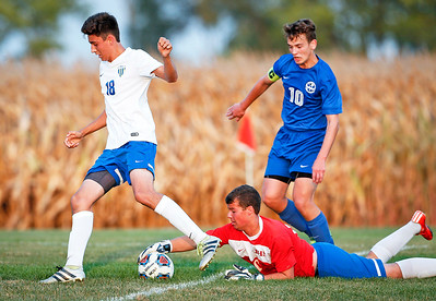 Shane Graef (18) from Johnsburg runs past Goalie Ryan Roos as he reaches for the ball in front of Caleb Warmbier (10) from Woodstock during the second half of their game at Johnsburg High School on Monday, October 2, 2017 in Johnsburg, Illinois. The Blue Streaks won the game 5-4 in a shoot out. John Konstantaras photo for Shaw Media