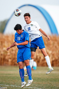 Shane Graef (18) from Johnsburg heads a ball over Daniel Gonzalez (19) from Woodstock during the first half of their game at Johnsburg High School on Monday, October 2, 2017 in Johnsburg, Illinois. The Blue Streaks won the game 5-4 in a shoot out. John Konstantaras photo for Shaw Media
