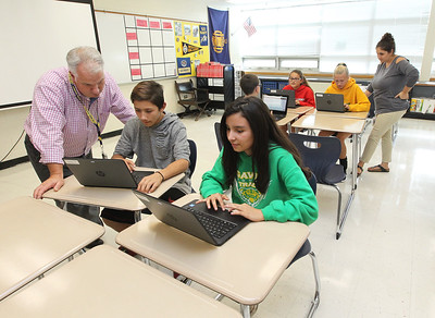 Candace H. Johnson-For Shaw Media Teachers Michael Dean and Stephanie Kaye work with their eighth grade students on how to use Google Classroom on HP ProBook x360 Notebook PC laptops at Gavin South Middle School in Ingleside. Dean and Kaye raised $7000 through private donations and a GoFundMe campaign to purchase the Chromebook laptops for their students.