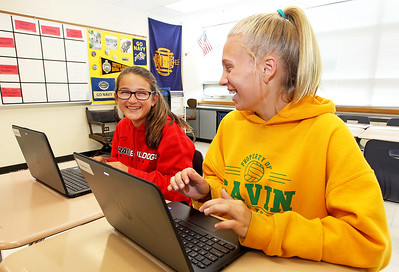 Candace H. Johnson-For Shaw Media Eighth graders Miranda Rodriguez, 14, and Cora Hughs, 13, share a laugh while working on brand-new HP ProBook x360 Notebook PC laptops at Gavin South Middle School in Ingleside.