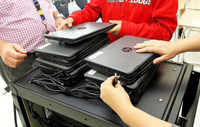 Candace H. Johnson-For Shaw Media Eighth grade teachers Michael Dean and Stephanie Kaye wait for their students to put back their HP ProBook x360 Notebook PC laptops on the cart at Gavin South Middle School in Ingleside.Both Dean and Kaye raised $7000 through social media and private donations to bring the laptops into the school.