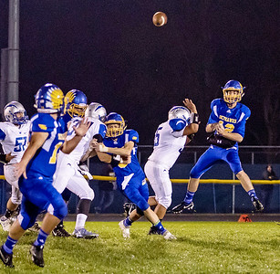 Johnsburg High School quarterback Adam Jayko throws a pass down field against Woodstock Friday, October 6, 2017 in Johnsburg. Johnsburg improves to 7-0 with the 42-20 win. KKoontz – For Shaw Media