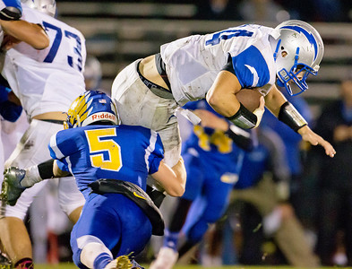 Woodstock High School running back Sean Doyle (34) is tackled by Johnsburg linebacker Jack Kegel (5) Friday, October 6, 2017 in Johnsburg. Johnsburg improves to 7-0 with the 42-20 win. KKoontz – For Shaw Media