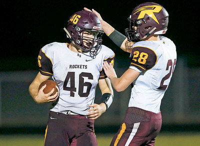 Mike Kaufman (46) from Richmond-Burton celebrates his touchdown with Payton Minzey (28) during the third quarter of their game against Marengo on Friday, October 6, 2017 in Marengo, Illinois. John Konstantaras photo for Shaw Media