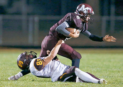 Jake Rupnik (89) from Richmond-Burton sacks Travis Knaak (8) from Marengo during the fourth quarter of their game at Marengo High School on Friday, October 6, 2017 in Marengo, Illinois. John Konstantaras photo for Shaw Media