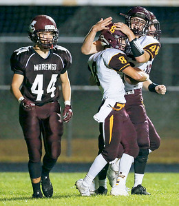 Richard Botzoc (44) from Marengo walks by as Matthew Kortan (8) celebrates his touchdown with Mike Kaufman (46) from Richmond-Burton during the second quarter of their game at Marengo High School on Friday, October 6, 2017 in Marengo, Illinois. John Konstantaras photo for Shaw Media