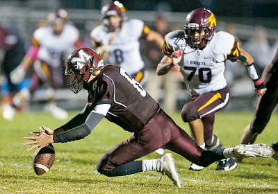 Quarterback Travis Knaak (8) from Marengo falls on the ball after a bobbled snap during the second quarter of their game against Richmond-Burton at Marengo High School on Friday, October 6, 2017 in Marengo, Illinois. John Konstantaras photo for Shaw Media
