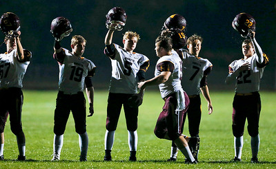 Josh Dumont (51) from Richmond-Burton bumps helmets with his teammates after the national anthem before their game against Marengo on Friday, October 6, 2017 in Marengo, Illinois. John Konstantaras photo for Shaw Media