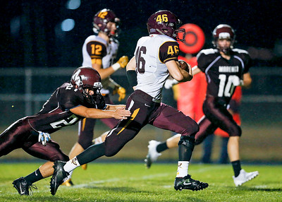 Mike Kaufman (46) from Richmond-Burton out runs Michael Anderson (21) from Marengo for a touchdown during the first quarter of their game at Marengo High School on Friday, October 6, 2017 in Marengo, Illinois. John Konstantaras photo for Shaw Media