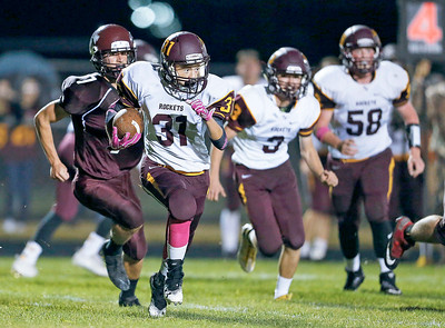 Anthony Rivera (31) from Richmond-Burton returns an interception during the fourth quarter of their game against  Marengo on Friday, October 6, 2017 in Marengo, Illinois. John Konstantaras photo for Shaw Media