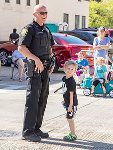 Brody Vore (3yrs) from Belvidere IL, checks the start time of the parade with Marengo Police officer Rzotkiewicz during Settlers' Days in Marengo Sunday, October 8, 2017.  KKoontz- For Shaw Media