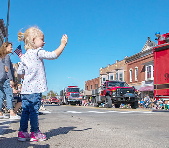 Addie Mortimer (2yrs) from Woodstock waves as the fire trucks make their way down the parade route during Settlers' Days in Marengo Sunday, October 8, 2017. KKoontz- For Shaw Media