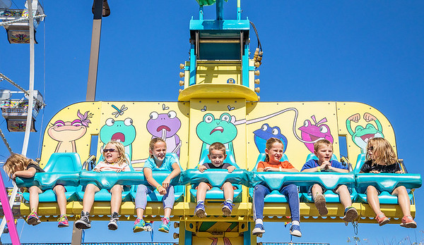 Kids take to the sky on the Frog Hopper ride during Settlers' Days in Marengo Sunday, October 8, 2017.  KKoontz- For Shaw Media