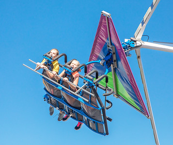 Anna and Finley Kunzer from Marengo fly through the sky on the Cliff Hanger during Settlers' Days in Marengo Sunday, October 8, 2017.  KKoontz- For Shaw Media