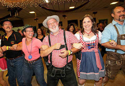 Candace H. Johnson-For Shaw Media Frank and Christine Gieber, of Littleton, Colo., Richard Noeller, Kony Klein, both of Chicago, and Scott Klapper, of Geneva, dance to a traditional German song by the band, Phenix, during Oktoberfest at the American Aid Society of German Descendants in Lake Villa.