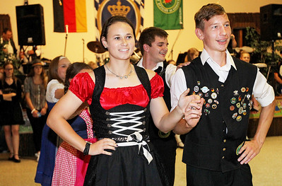 Candace H. Johnson-For Shaw Media Tara Nikolich, 18, and her partner, Christian Kiefhaber, 24, both of Chicago with the Youth Group dance to German folk music during Oktoberfest at the American Aid Society of German Descendants in Lake Villa.