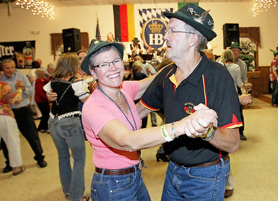 Candace H. Johnson-For Shaw Media Christine and Frank Gieber, of Littleton, Colo., dance to traditonal German music performed by the band, Phenix, during Oktoberfest at the American Aid Society of German Descendants in Lake Villa.