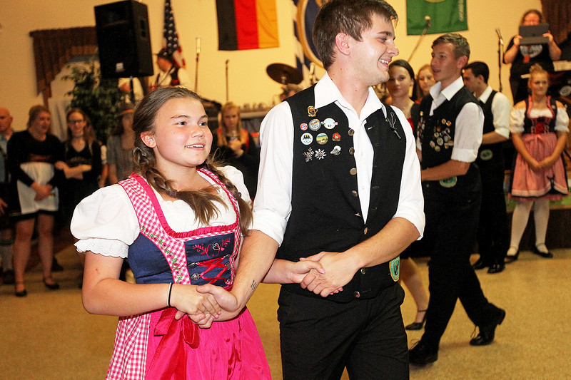 Candace H. Johnson-For Shaw Media Ella Palffy, 14, of Arlington Heights dances to traditional German folk music with a member of the Youth Group during Oktoberfest at the American Aid Society of German Descendants in Lake Villa.