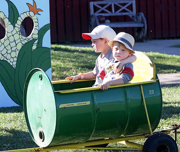 Candace H. Johnson-For Shaw Media Hunter Savage, 3, of Spring Grove and his cousin, Aiden Leeson, 2, of Libertyville go on a Barrel Train ride during Fall on the Farm at Lambs Farm in Libertyville.