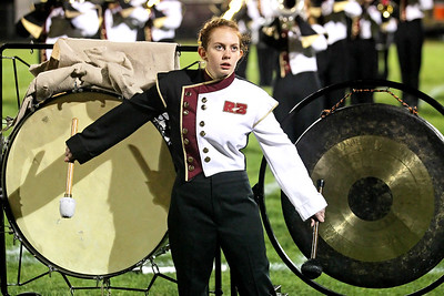 Candace H. Johnson-For Shaw Media Richmond-Burton's Olivia Davis, 16, plays the bass drum and the gong at half-time with the Rocket Marching Band during the varsity football game against Genoa-Kingston at Richmond-Burton High School.