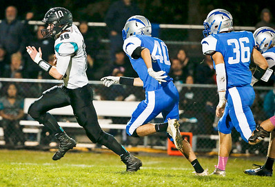 Quarterback Collin Mergl (10) from Woodstock North runs for a touchdown during the first quarter against Woodstock on Friday, October 13, 2017 in Woodstock, Illinois. John Konstantaras photo for Shaw Media