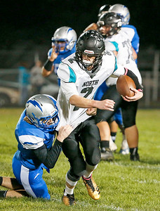 Quarterback Carter Coalson (2) from Woodstock North is tackled as he runs for a first down during the first quarter at Woodstock High School on Friday, October 13, 2017 in Woodstock, Illinois. John Konstantaras photo for Shaw Media