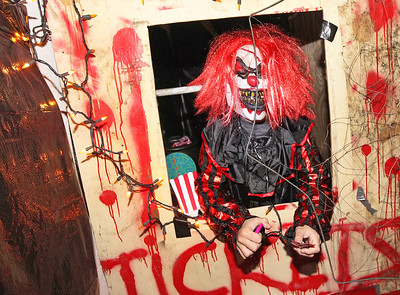 Candace H. Johnson-For Shaw Media Tyler Collins, 9, of Lindenhurst dressed up as a scary clown as he sits in a ticket booth handing out candy to kids in the Haunted Trail at the Lindenhurst Park District's Community Center on Grass Lake Road.