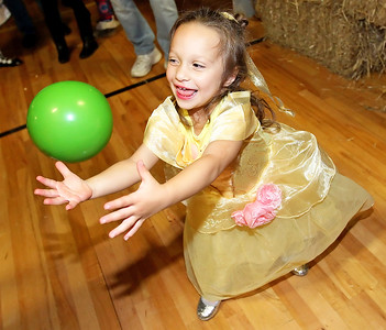 Candace H. Johnson-For Shaw Media Brooklyn Forth, 3, of Lindenhurst looks to catch the ball as she plays basketball for a prize during the Haunted Trail at the Lindenhurst Park District's Community Center on Grass Lake Road.